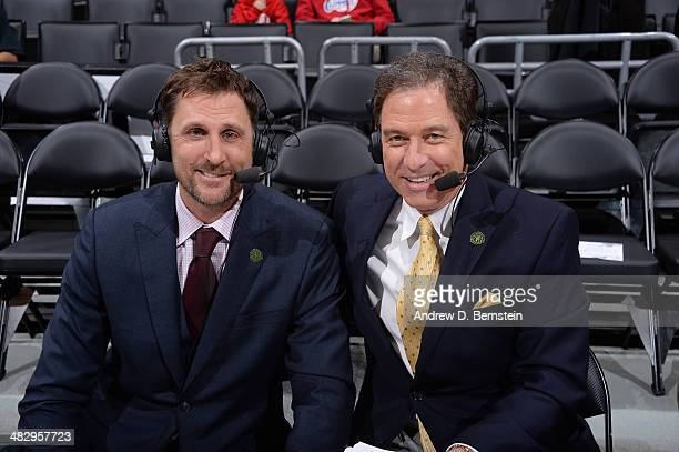 TNT's Brent Barry and Kevin Harlan pose for a photograph while wearing Green Week lapel pins at Staples Center on April 3 2014 in Los Angeles...