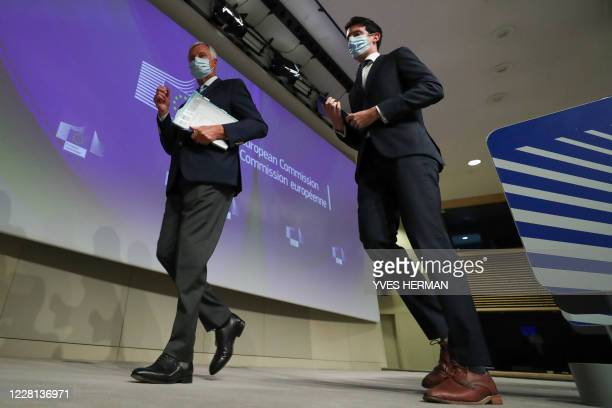 S Brexit negotiator Michel Barnier leaves with European Commission spokesman Daniel Ferrie after a news conference, after a meeting with Britain's...