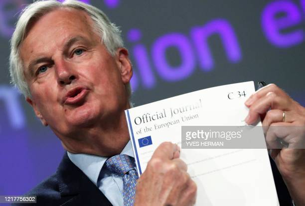 EU's Brexit negotiator Michel Barnier shows documents as he gives a press conference after a Brexit negotiations meeting at the EU Commission in...