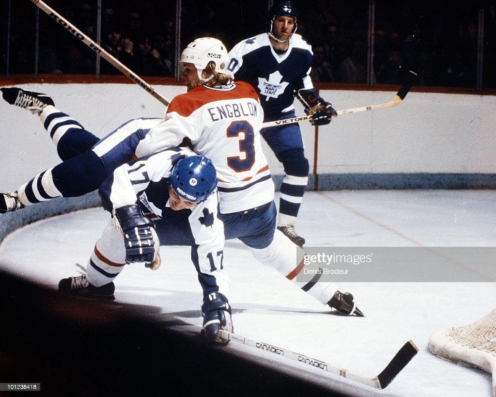 MONTREAL - 1970's: Brian Engblom #3 of the Montreal Canadiens checks an opponent of the Toronto Maple Leafs into the boards during the 1970's at the Montreal Forum in Montreal, Quebec, Canada. Engblom played for the Canadiens from 1976-1982.