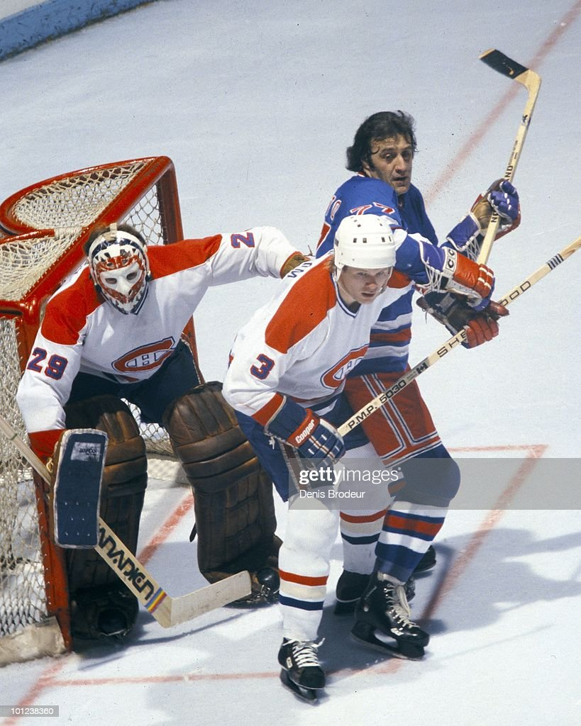 MONTREAL - 1970's: Brian Engblom #3 of the Montreal Canadiens helps to protect the net with goalie Ken Dryden #29 against Phil Esposito of the New York Rangers in the 1970's at the Montreal Forum in Montreal, Quebec, Canada. Engblom played for the Canadiens from 1976-1982.