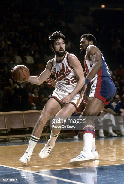 MILWAUKEE WI CIRCA 1970's Brian Winters of the Milwaukee Bucks drive the baseline against a New Jersey Nets defender during an mid circa 1970's NBA...
