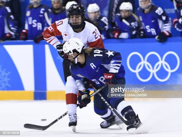 USA's Brianna Decker drives past Canada's Sarah Nurse in the women's gold medal ice hockey match between Canada and the US during the Pyeongchang...