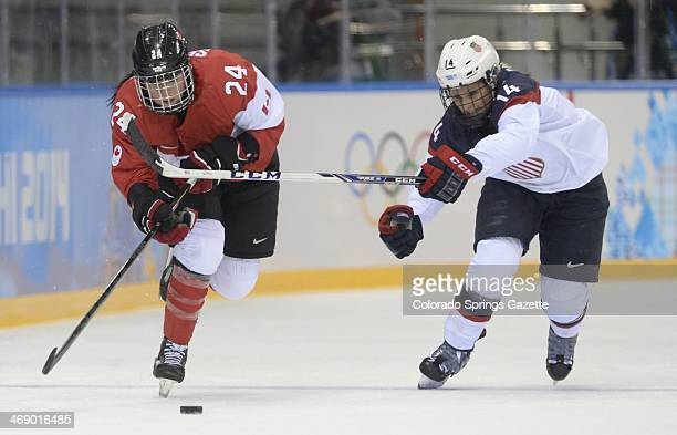 USA's Brianna Decker right chases down Canada's Natalie Spooner in the first period of a women's hockey game at the Winter Olympics in Sochi Russia...