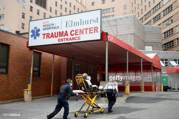EMT's bring in a patient to Elmhurst Hospital trauma center in New York United States n April 26 2020 Elmhurst Hospital Trauma Center In Queens...