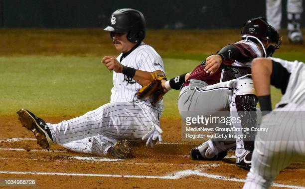 LBSU's Brock Lundquist beats the tag at home by Fordham catcher Justin Bardwell in the 1st inning in Long Beach CA on Friday February 24 2017...