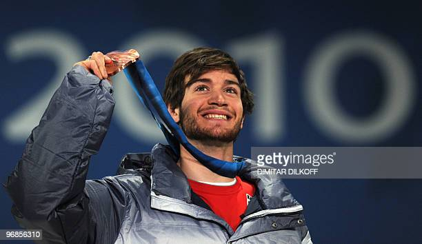 USA's bronze medalist Scott Lago celebrates on the podium during the medal ceremony of the men's snowboard halfpipe event of the Winter Olympics in...