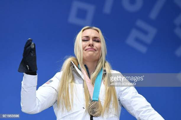 S bronze medallist Lindsey Vonn cries on the podium during the medal ceremony for the alpine skiing Women's Downhill at the Pyeongchang Medals Plaza...