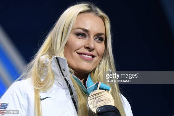 TOPSHOT USA's bronze medallist Lindsey Vonn poses on the podium during the medal ceremony for the alpine skiing Women's Downhill at the Pyeongchang...