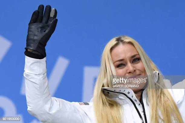 TOPSHOT USA's bronze medallist Lindsey Vonn tears up on the podium during the medal ceremony for the alpine skiing Women's Downhill at the...