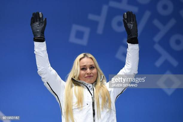 S bronze medallist Lindsey Vonn tears up on the podium during the medal ceremony for the alpine skiing Women's Downhill at the Pyeongchang Medals...
