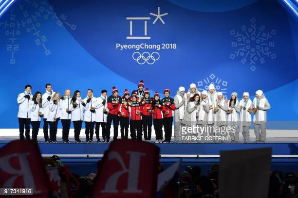 USA's bronze medallists Canada's gold medallists and Olympic Athletics from Russia silver medallists pose on the podium during the medal ceremony for...