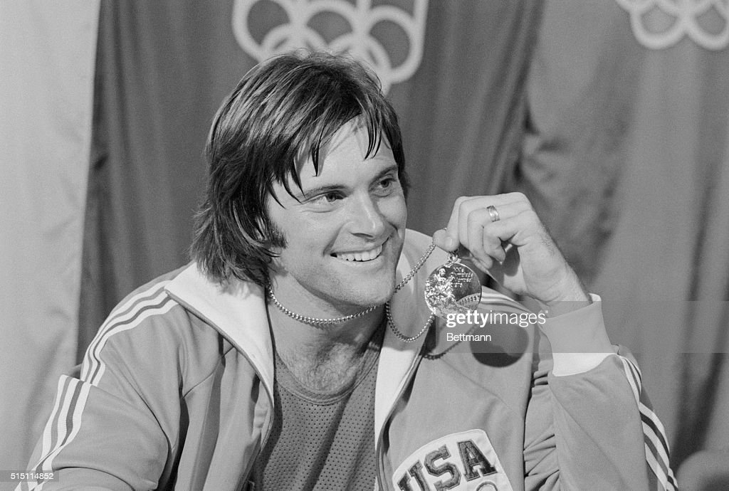 USA's Bruce Jenner, San Jose, CA., displays the gold medal he won in the Olympic decathlon here 7/30.