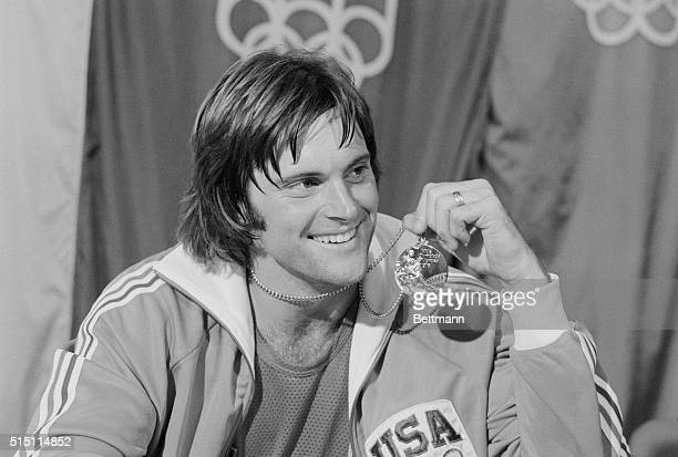 USA's Bruce Jenner San Jose CA displays the gold medal he won in the Olympic decathlon here 7/30