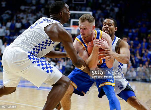 UCLA's Bryce Alford middle is tied up by Kentucky's Bam Adebayo and Isaiah Briscoe on Saturday Dec 3 at Rupp Arena in Lexington Ky UCLA won 9792