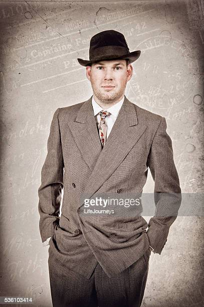 1940's business man in suit hat and tie - fedora stock pictures, royalty-free photos & images
