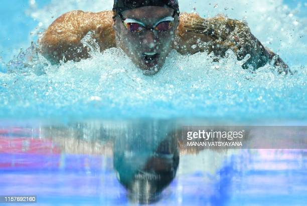 USA's Caeleb Dressel competes and makes a world record in a semifinal of the men's 100m butterfly event during the swimming competition at the 2019...