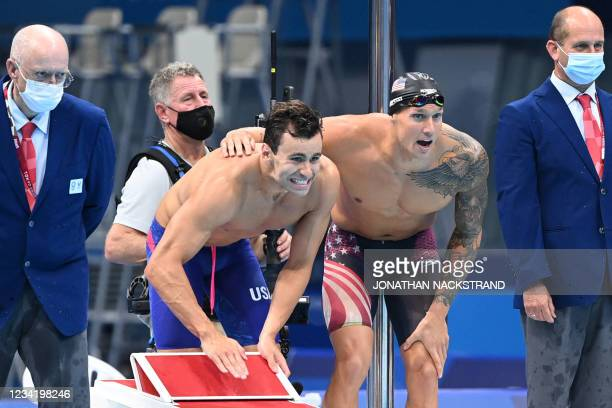 S Caeleb Dressel reacts as USA's Blake Pieroni, Bowen Becker and Zach Apple compete to win the final of the men's 4x100m freestyle relay swimming...