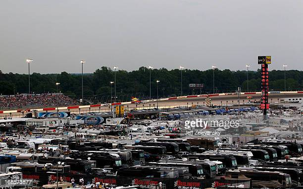 S, Campers and haulers are seen parked on the infield as cars race down the backstretch during the NASCAR Sprint Cup Series Bojangles' Southern 500...