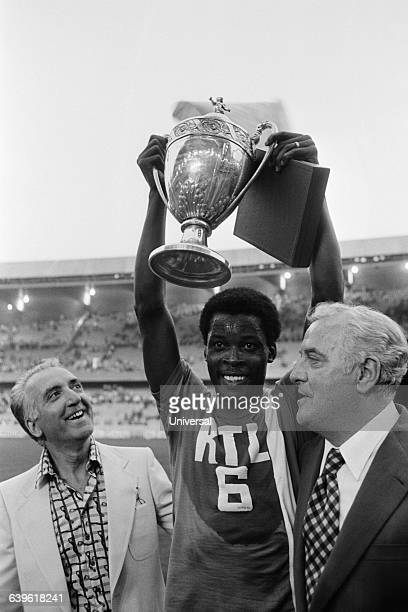 OM's captain Marius Tresor holds the trophy next to Fernand Meric OM's President following Olympique de Marselle's 20 victory over Olympique Lyonnais...