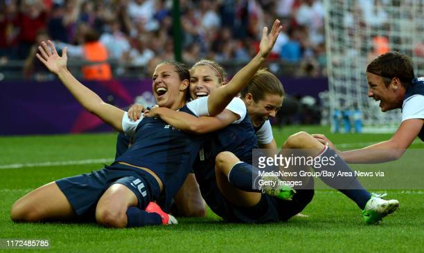 USA's Carli Lloyd celebrates her first goal with Kelley O'Hara Alex Morgan and Abby Wambach in the first half of their game against Japan for the...
