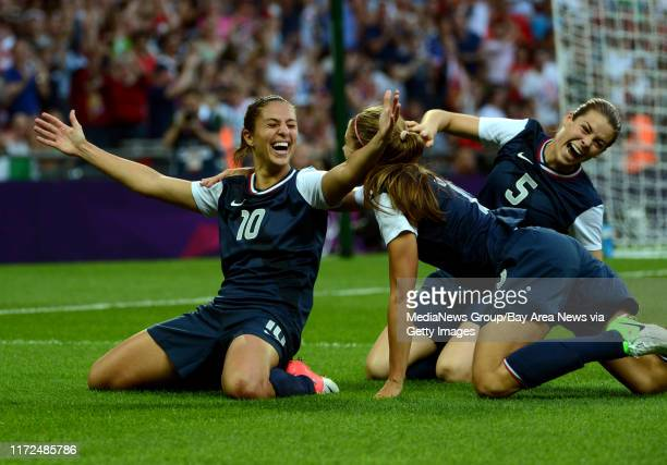 USA's Carli Lloyd celebrates her first goal with Kelley O'Hara and Alex Morgan in the first half of their game against Japan for the Women's Soccer...