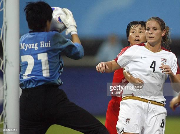 USA's Cat Whitehill eyes a ball catched by North Korea's goalkeeper Jon Myong Hui as Sonu Kyong Sun defends during a group B match USA vs North Korea...