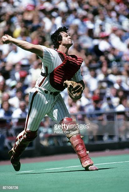 PHILADELPHIA PA CIRCA 1970's Catcher Bob Boone of the Philadelphia Phillies after fielding a bunt sets to throw to first base during a late circa...