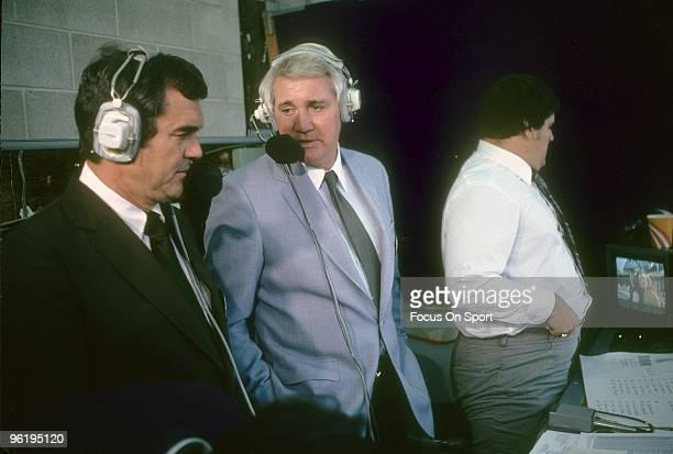 CIRCA 1980's CBS NFL play by play announcer Pat Summerall and color commentator Tom Brookshier in the booth calling an NFL football game mid circa...