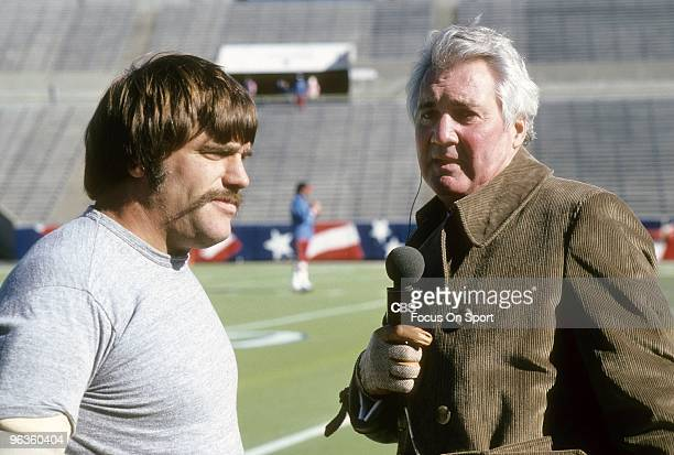 Play by play announcer Pat Summerall on the field interviewing Linebacker Jack Reynolds of the San Francisco 49ers prior to the start of an NFL...