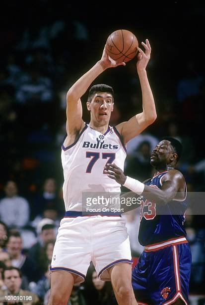 BALTIMORE MD CIRCA 1990's Center Gheorghe Muresan of the Washington Bullets is guarded closely by Patrick Ewing of the New York Knicks circa mid...