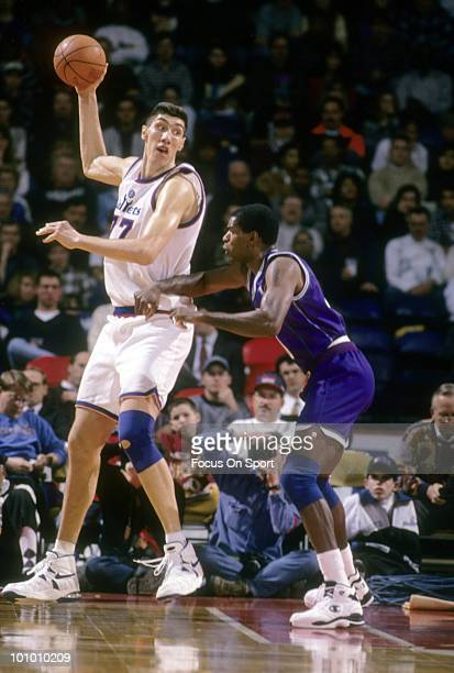 BALTIMORE MD CIRCA 1990's Center Gheorghe Muresan of the Washington Bullets is guarded by center Robert Parish of the Charlette Hornets circa mid...