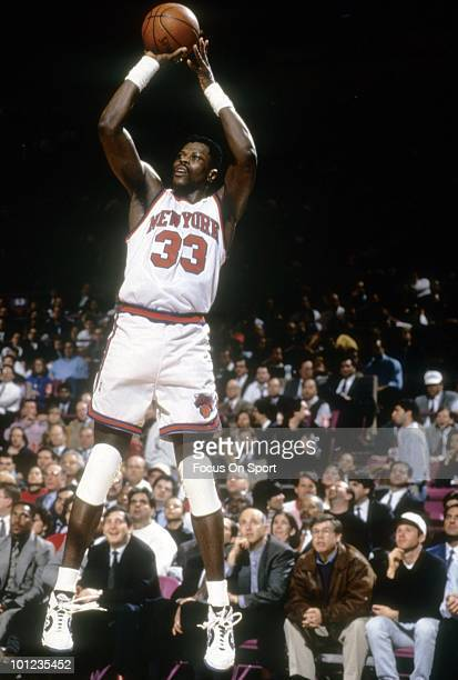MANHATTAN NY CIRCA 1990's Center Patrick Ewing of the New York Knicks in action shoots an outside shot circa early 1990's during an NBA basketball...