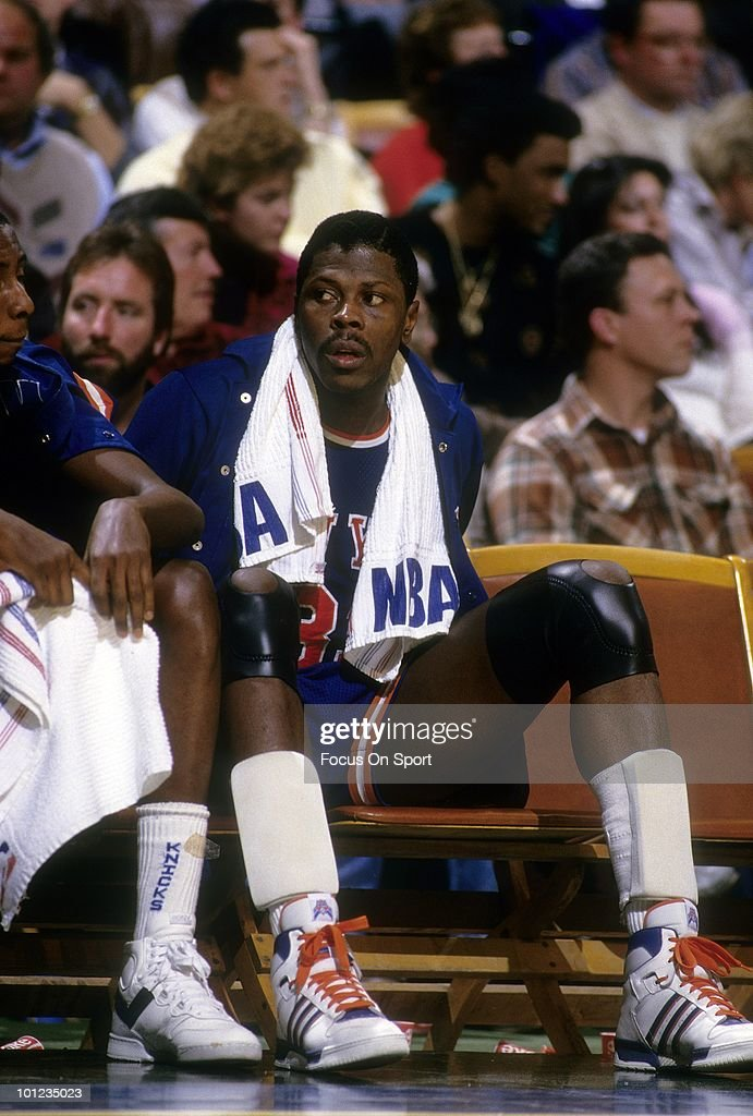 MILWAUKEE, WI - CIRCA 1980's: Center Patrick Ewing #33 of the New York Knicks in this portrait watching the action from the bench circa late 1980's during an NBA basketball game against the Milwaukee Bucks at the Milwaukee Arena in Milwaukee, Wisconsin. Ewing played for the Knicks from 1985-00.
