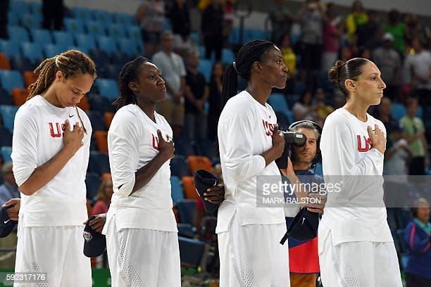 USA's centre Brittney Griner USA's centre Tina Charles USA's centre Sylvia Fowles and USA's guard Diana Taurasi listen to the national enthems prior...
