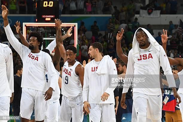 USA's centre DeAndre Jordan USA's guard Demar Derozan USA's guard Klay Thompson and USA's guard Kevin Durant gesture after defating Argentina during...