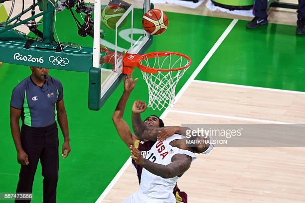 TOPSHOT USA's centre DeMarcus Cousins collides with Venezuela's shooting guard John Cox during a Men's round Group A basketball match between USA and...