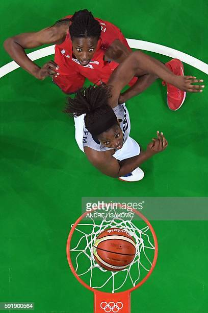 USA's centre Sylvia Fowles and France's power forward Endy Miyem eye a rebound during a Women's semifinal basketball match between France and USA at...