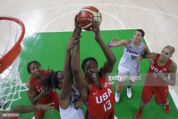USA's centre Sylvia Fowles and France's power forward Endy Miyem go for a rebound during a Women's semifinal basketball match between France and USA...