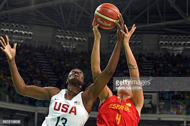 USA's centre Sylvia Fowles and Spain's power forward Laura Nicholls go for a rebound during a Women's Gold medal basketball match between USA and...