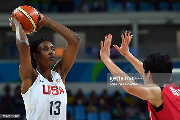 USA's centre Sylvia Fowles faces Japan's small forward Yuka Mamiya during a Women's quarterfinal basketball match between USA and Japan at the...