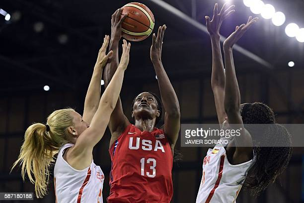 USA's centre Sylvia Fowles goes to the basket despite Spain's power forward Laura Gil and Spain's power forward Astou Ndour during a Women's round...