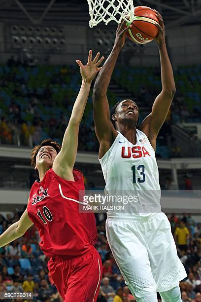 USA's centre Sylvia Fowles goes to the basket past Japan's power forward Ramu Tokashiki during a Women's quarterfinal basketball match between USA...