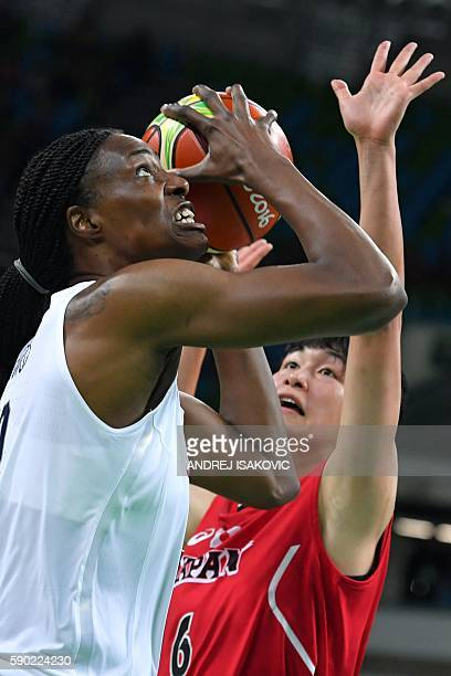 USA's centre Sylvia Fowles goes to the basket past Japan's small forward Yuka Mamiya during a Women's quarterfinal basketball match between USA and...