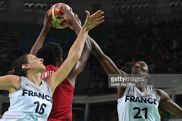 USA's centre Sylvia Fowles is blocked by France's centre Helena Ciak and France's power forward Laetitia Kamba during a Women's semifinal basketball...