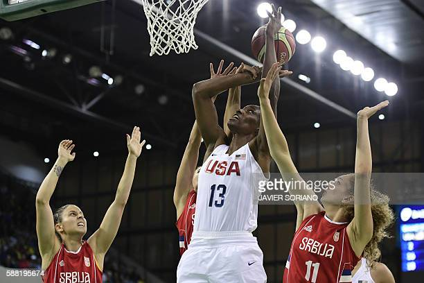 USA's centre Sylvia Fowles jumps for a basket by Serbia's small forward Aleksandra Crvendakic during a Women's round Group B basketball match between...