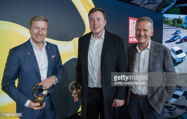 BMW's CEO Oliver Zipse Elon Musk CEO of Tesla and SpaceX and Volkswagen CEO Herbert Diess pose after the award ceremony for the 43rd Goldenes Lenkrad...