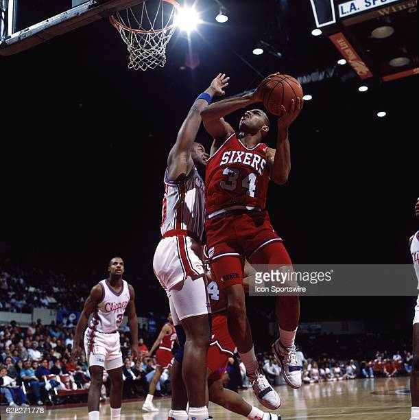 1990's Charles Barkley of the Philadelphia 76ers goes up for a shot during a Sixers game versus the Los Angeles Clippers at the Los Angeles Sports...
