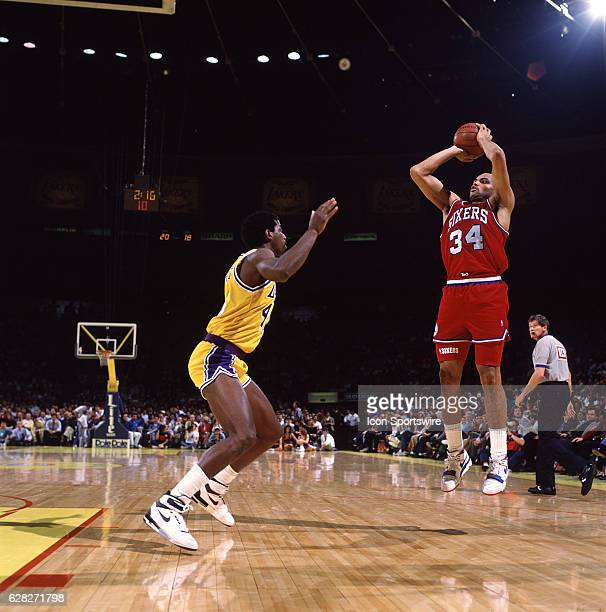 1990's Charles Barkley of the Philadelphia 76ers goes up for a shot during a Sixers game versus the Los Angeles Lakers at the Great Western Forum in...