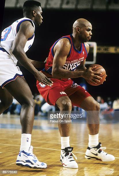 BALTIMORE MD CIRCA 1990's Charles Barkley of the Philadelphia 76ers in action backing in against a Washington Bullets defender during a early circa...